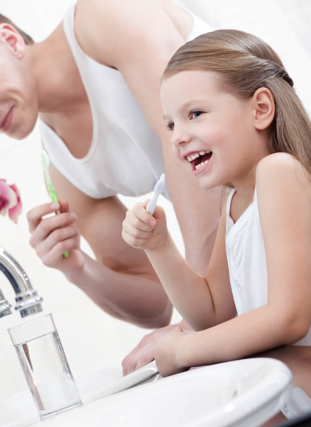 Girl Brushes Teeth With Her Father